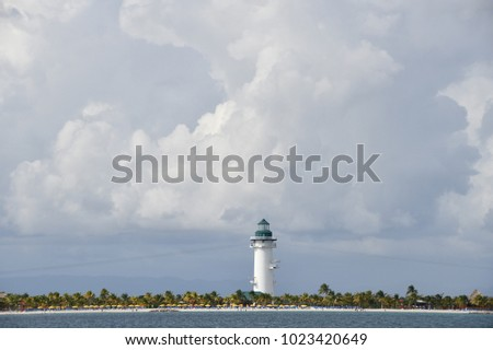 lighthouse on a small caribbean island on a stormy morning