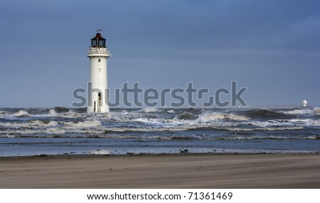 Lighthouse on a stormy day - stock photo