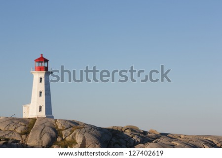 Lighthouse on a sunny day with blue sky - stock photo