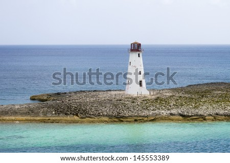 Lighthouse on an island on a cloudy day - stock photo