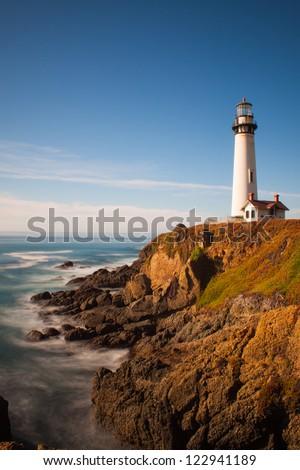 Lighthouse On Cliff - stock photo