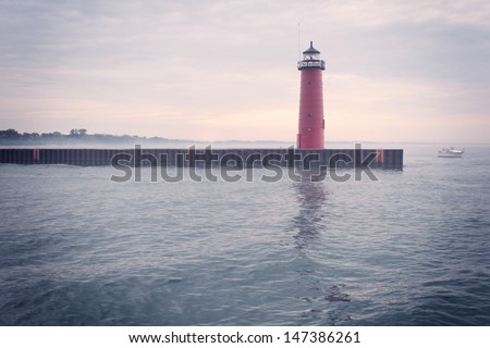 Lighthouse on Lake Michigan on a foggy day - stock photo
