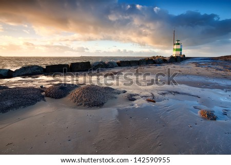 lighthouse on North sea in Ijmuiden, Holland - stock photo