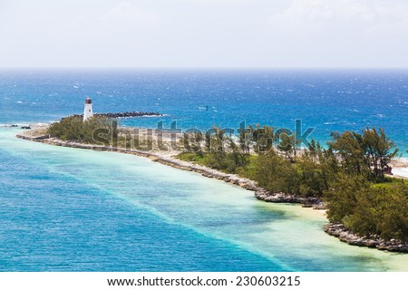 Lighthouse on Point of land near Nassau on Grand Bahamas - stock photo