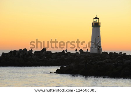 Lighthouse on sunset sky