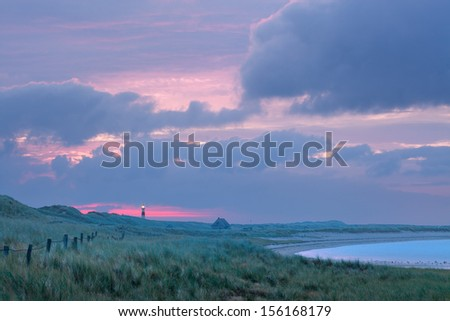 lighthouse on the coast - stock photo