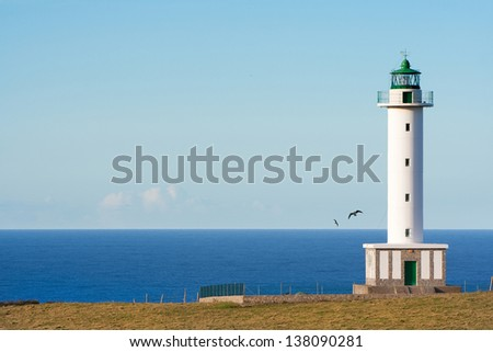 Lighthouse on the coast of Asturias. - stock photo