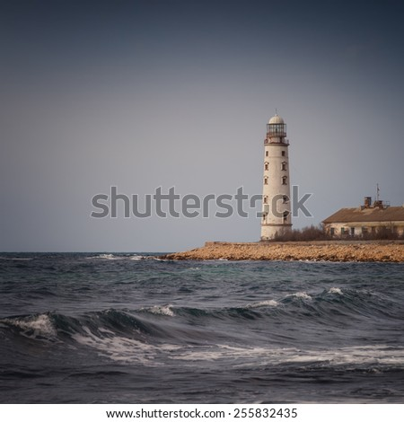 Lighthouse on the coast on the background of sky  - stock photo