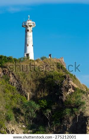 Lighthouse on The Coastal Slopes - stock photo