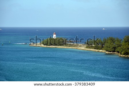Lighthouse on the coastline of the Bahamas in the Caribbean - stock photo