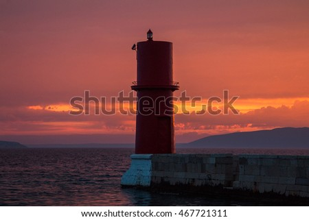 Lighthouse on the Cres Island in Croatia, seascape, cloudy sunset, summer evening