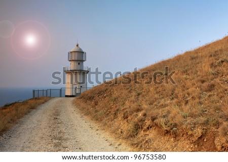 Lighthouse on the ocean beach - stock photo