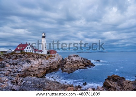 Lighthouse on the ocean, Portland. Maine United States. dusk, dark time, heavy low clouds, stormy sky.  Night. clouds running at slow shutter speeds