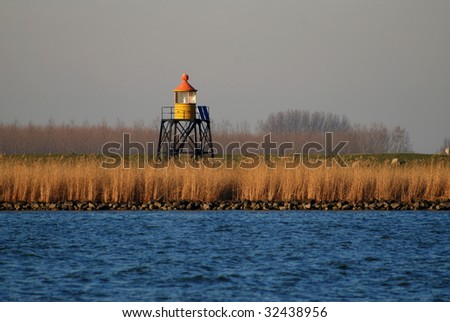Lighthouse on the shore of a river
