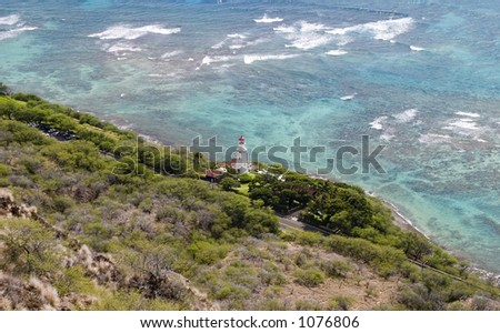 Lighthouse on the shores of South Oahu, just below Diamond Head volcano. - stock photo