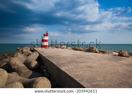 Lighthouse on the Tavira Island before storm, Algarve,Portugal - stock photo