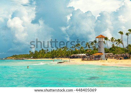 Lighthouse on the tropical shores of  Dominican Republic.