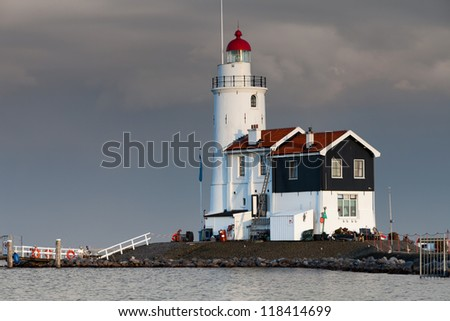 Lighthouse Paard van Marken at sunset, North Holland, Netherlands - stock photo