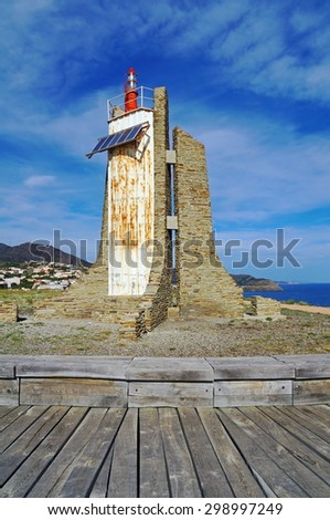 Lighthouse powered by solar panels on the Cap Cerbere at the frontier between Spain and France, Mediterranean - stock photo