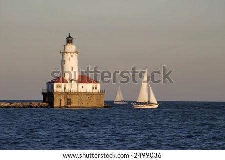 Lighthouse Sail - stock photo