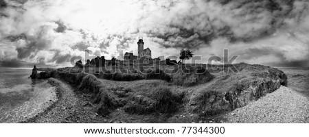 lighthouse sea ocean wave clouds seascape panorama black & white - stock photo