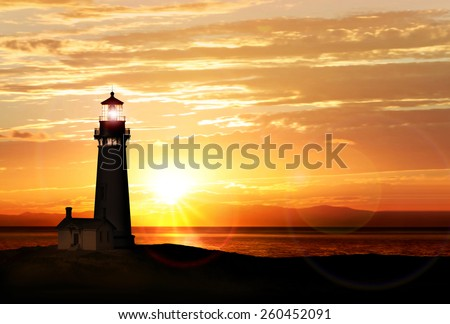 Lighthouse searchlight beam near ocean at sunset - stock photo