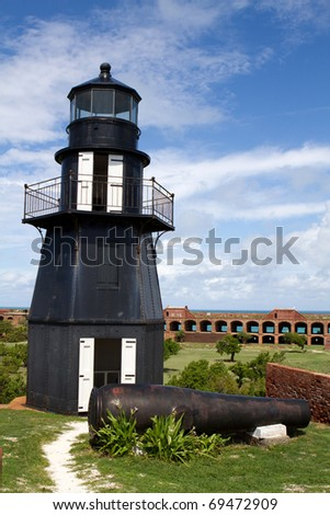 Lighthouse sits atop the upper level of the wall of Fort Jefferson National Park in the Dry Tortugas, part of the Florida Keys. - stock photo