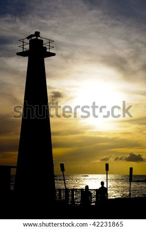 Lighthouse situalte with the sea and sunset - stock photo