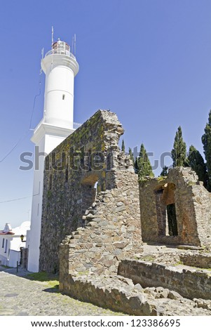 Lighthouse. The small town of Colonia del Sacramento, Uruguay, is one of the top tourist destinations for residents of Buenos Aires & Argentine and Uruguayan general. - stock photo