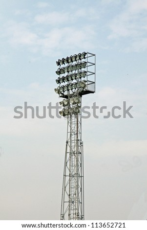 Lighthouse tower with a lot of lights to illuminate the football stadium - stock photo
