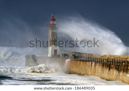 Lighthouse under heavy storm but with beautiful daylight - stock photo