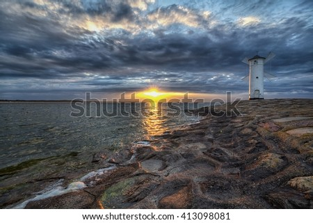 Lighthouse windmill Stawa Mlyny in Swinoujscie, Baltic Sea, Poland. - stock photo
