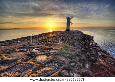 Lighthouse windmill Stawa Mlyny, Swinoujscie, Baltic Sea, Poland. - stock photo