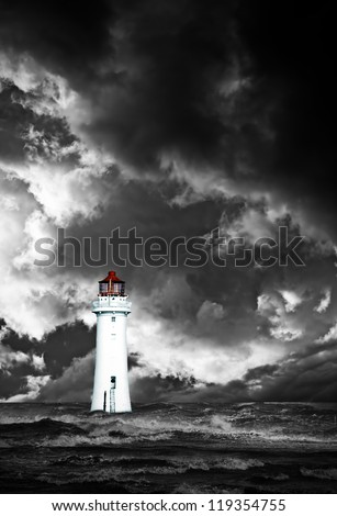 Lighthouse with approaching dramatic storm clouds - stock photo