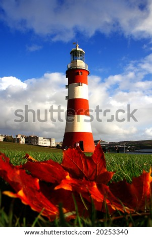 Lighthouse with autumn leaves, Plymouth, UK - stock photo