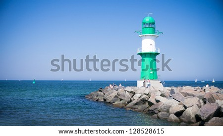 lighthouse with blue sky in warnemuende - stock photo