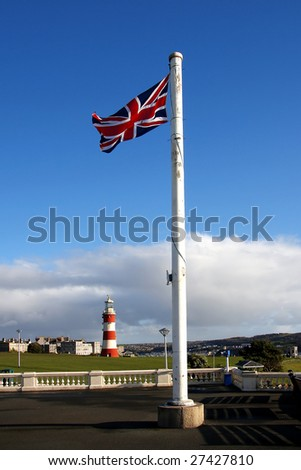 lighthouse with flag of england, Plymouth, UK - stock photo