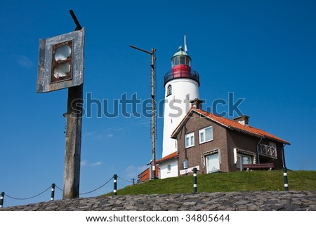 Lighthouse with old foghorn of Urk, fishing village in the Netherlands