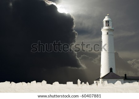 Lighthouse with storm approaching - stock photo