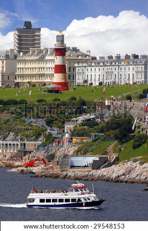 lighthouse with tourist ship, Plymouth, UK - stock photo