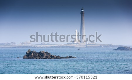 Lighthouses in france in a foggy morning