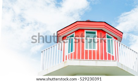 lighthouses with clear sky ,red dome placed on the roof