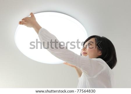 Lighting and Asian women - stock photo