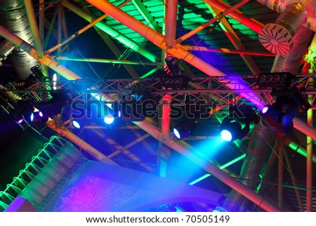 lighting equipment  at concert - colored spotlights on ceiling - stock photo