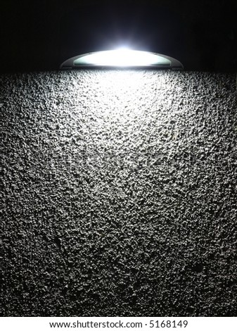 lighting fixture on stucco texture - stock photo