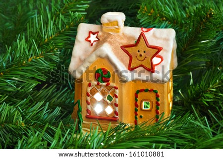 Lighting house and christmas tree - abstract holiday background - stock photo
