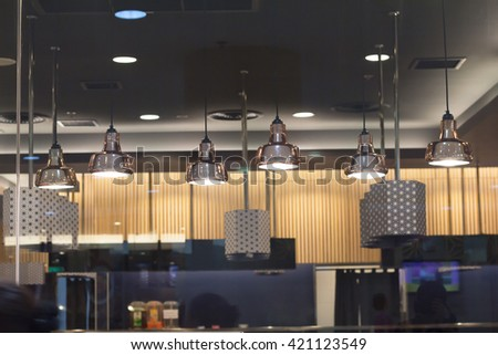 Lighting inside the restaurant in the mall, one of the background.