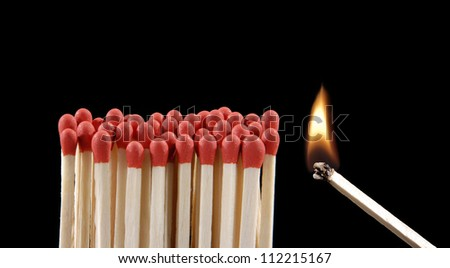 lighting matches on black background.Flaming matchsticks.
