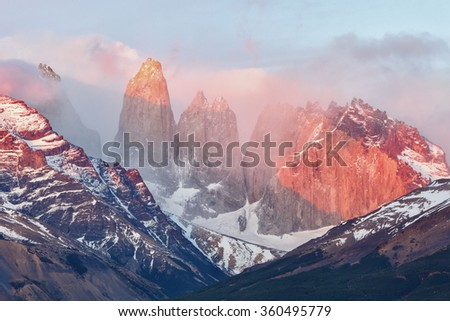Lighting of the Torres del Paine at sunrise. Torres del Paine National Park, Patagonia, Chile. - stock photo