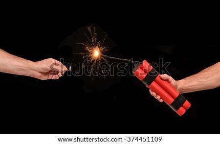Lighting on a dynamite stick. - stock photo